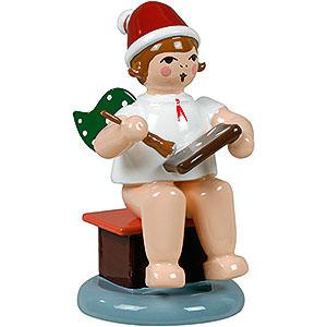 Weihnachtsengel Bäckerengel (Ellmann) Bäckerengel sitzend mit Mütze und Pfefferkuchen - 6,5 cm