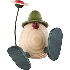 Kleine Figuren & Miniaturen Björn Köhler Eierköpfe klein Eierkopf Alfons mit Blume sitzend/tanzend, grün - 11 cm