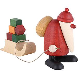 Kleine Figuren & Miniaturen Björn Köhler Weihnachtsmänner kl. Weihnachtsmann mit Geschenkeschlitten - 9cm
