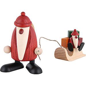 Kleine Figuren & Miniaturen Björn Köhler Weihnachtsmänner kl. Weihnachtsmann mit Schlitten und Kind - 9 cm