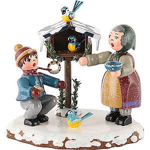 Kleine Figuren & Miniaturen Hubrig Winterkinder Winterkinder Vogelfütterung - 9 cm
